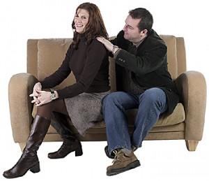 He's rubbing her shoulders